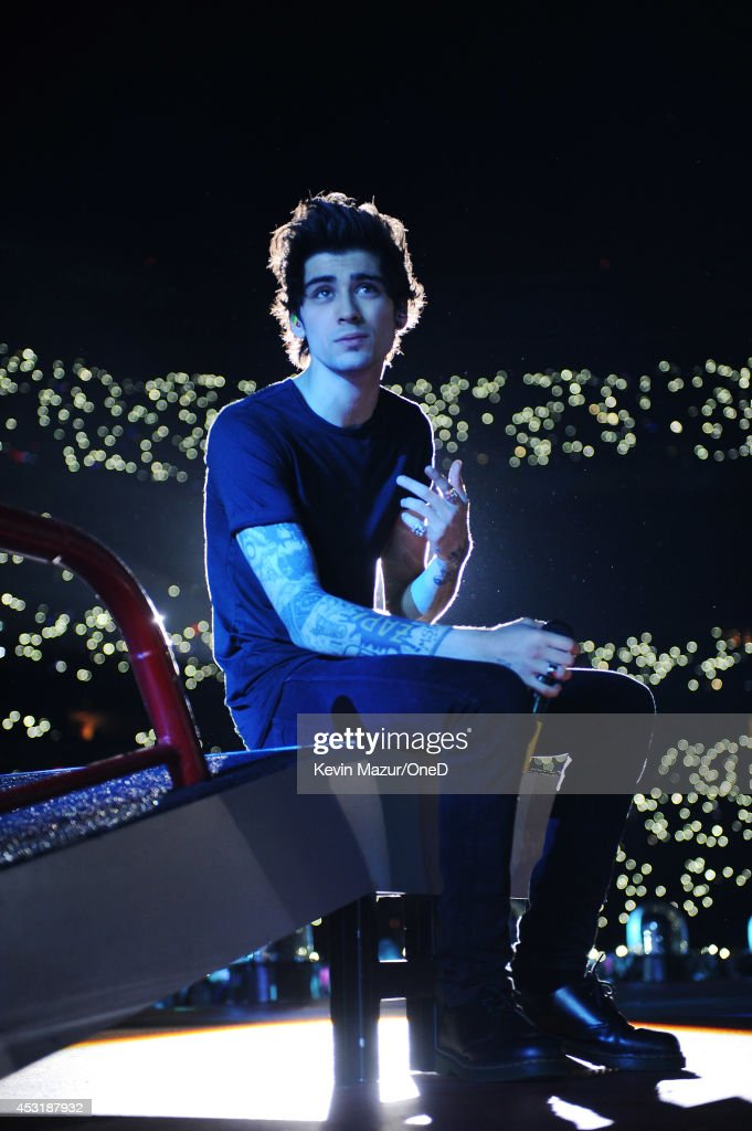 Zayn Malik of One Direction performs onstage during the 'Where We Are' tour at Met Life Stadium on August 4 2014 in New York City