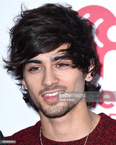 Zayn Malik poses in the 2014 iHeartRadio Music Festival Night 2 Press Room at MGM Grand Garden Arena on September 20 2014 in Las Vegas Nevada