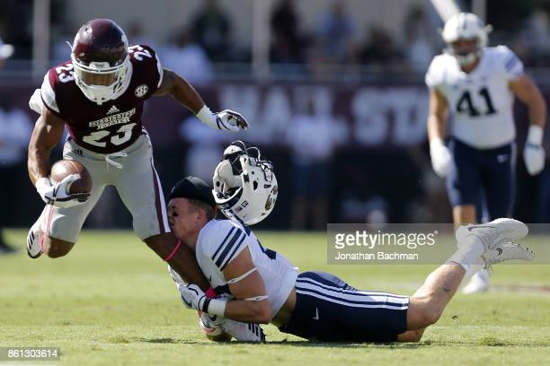 Zayne Anderson of the Brigham Young Cougars tackles Keith Mixon of the Mississippi State Bulldogs during the first half of a game at Davis Wade...