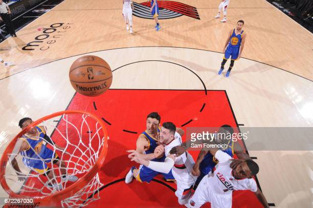 Zaza Pachulia and Draymond Green of the Golden State Warriors box out Jusuf Nurkic and Maurice Harkless of the Portland Trail Blazers in Game Three...