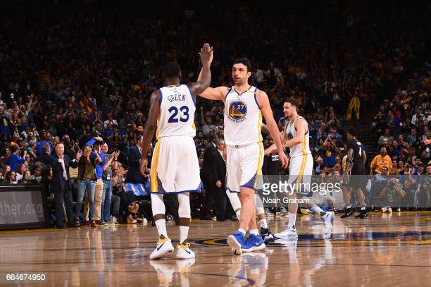 Zaza Pachulia and Draymond Green of the Golden State Warriors highfive during a game against the Minnesota Timberwolves on April 4 2017 at ORACLE...