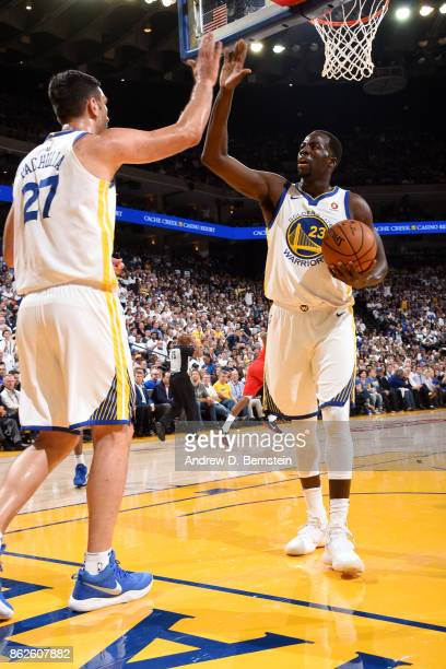 Zaza Pachulia and Draymond Green of the Golden State Warriors high five during the game against the Houston Rockets on October 17 2017 at ORACLE...