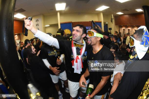 Zaza Pachulia and James Michael McAdoo of the Golden State Warriors celebrate in the locker room after winning the NBA Championship in Game Five of...