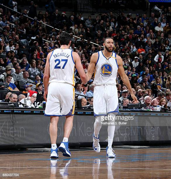 Zaza Pachulia and JaVale McGee of the Golden State Warriors shake hands during a game against the Brooklyn Nets on December 22 2016 at Barclays...