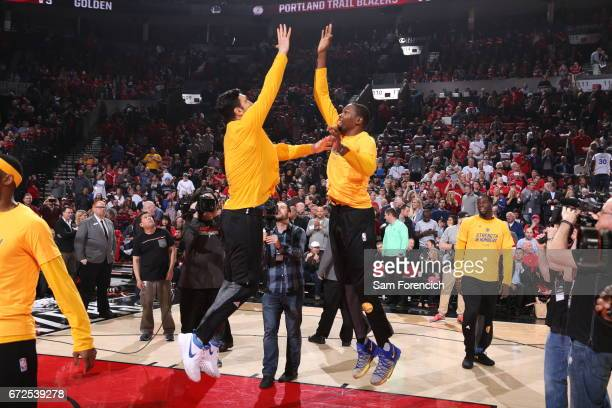 Zaza Pachulia and Kevin Durant of the Golden State Warriors high five before the game against the Portland Trail Blazers during Game Four of the...
