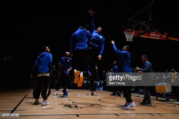 Zaza Pachulia and Kevin Durant of the Golden State Warriors high five before the game against the Denver Nuggets on November 4 2017 at the Pepsi...