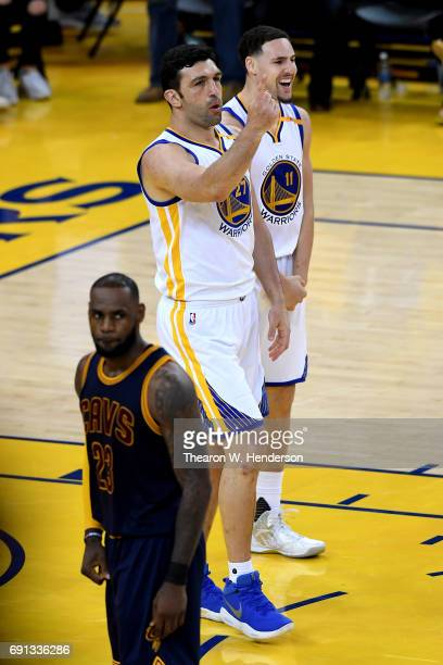 Zaza Pachulia and Klay Thompson of the Golden State Warriors reacts to a play against the Cleveland Cavaliers in Game 1 of the 2017 NBA Finals at...
