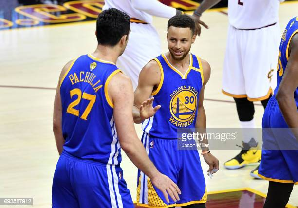 Zaza Pachulia and Stephen Curry of the Golden State Warriors react after a play in the first half against the Cleveland Cavaliers in Game 3 of the...