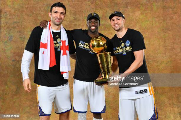 Zaza Pachulia Draymond Green and Klay Thompson of the Golden State Warriors poses for a portrait with the Larry O'Brien Trophy after defeating the...