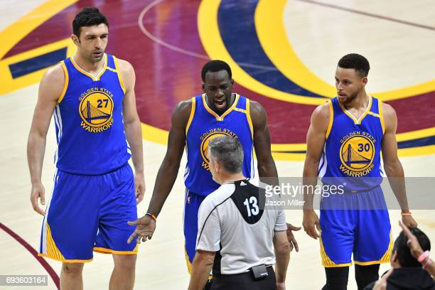 Zaza Pachulia Draymond Green and Stephen Curry of the Golden State Warriors complain to referee Monty McCutchen against the Cleveland Cavaliers...