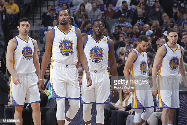 Zaza Pachulia Kevin Durant Draymond Green Stephen Curry and Klay Thompson of the Golden State Warriors face off against the Sacramento Kings on...