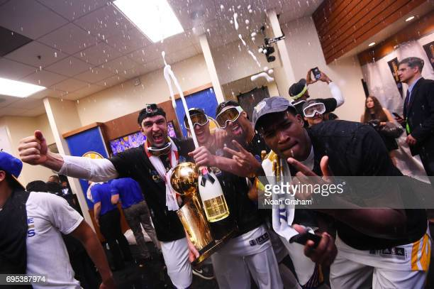 Zaza Pachulia Klay Thompson Andre Iguodala and Kevin Durant of the Golden State Warriors celebrate in the locker room after winning against the...