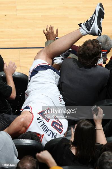 Zaza Pachulia of the Atlanta Hawks dives into the stands after a loose ball during a game against the Toronto Raptors on December 2 2009 at Philips...