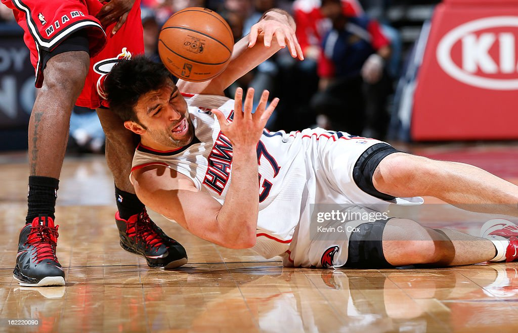 Zaza Pachulia #27 of the Atlanta Hawks draws a foul from LeBron James #6 of the Miami Heat as he battles for a loose ball at Philips Arena on February 20, 2013 in Atlanta, Georgia.