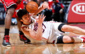 Zaza Pachulia of the Atlanta Hawks draws a foul from LeBron James of the Miami Heat as he battles for a loose ball at Philips Arena on February 20...