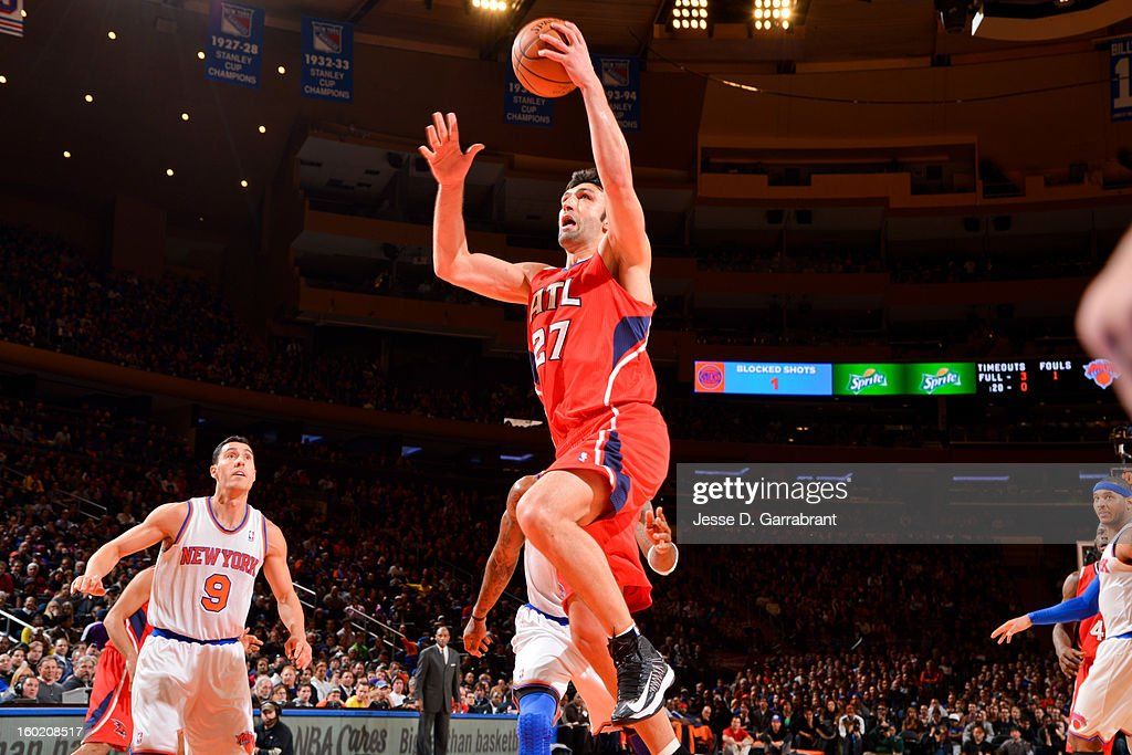 Zaza Pachulia #27 of the Atlanta Hawks drives to the basket against the New York Knicks at Madison Square Garden on January 27, 2013 in New York, New York.