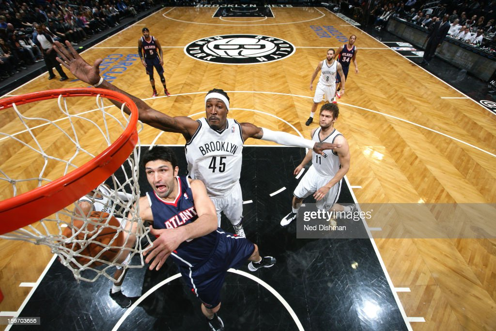 Zaza Pachulia #27 of the Atlanta Hawks goes up for the shot against Gerald Wallace #45 of the Brooklyn Nets at the Barclays Center on January 18, 2013 in the Brooklyn borough of New York City in New York City.