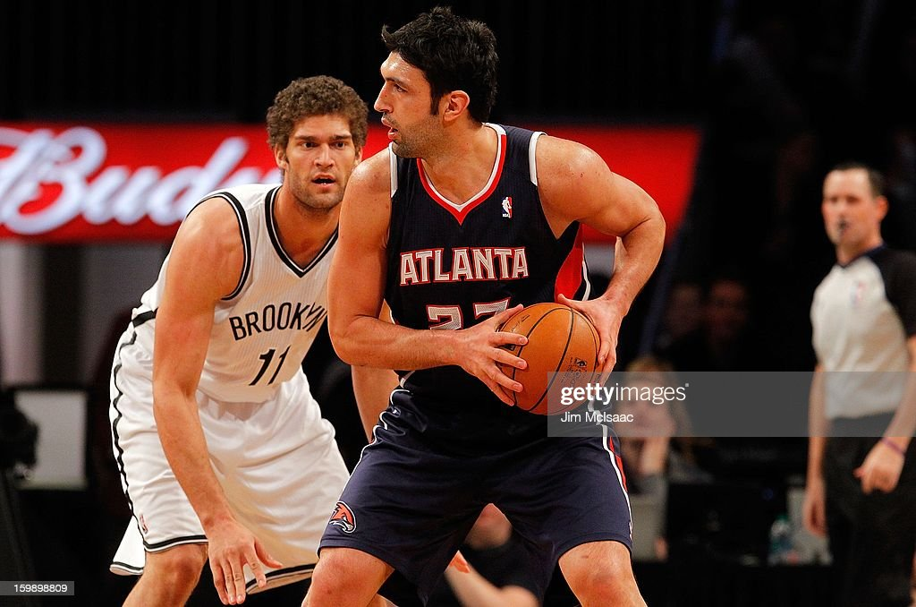 Zaza Pachulia #27 of the Atlanta Hawks in action against Brook Lopez #11 of the Brooklyn Nets at Barclays Center on January 18, 2013 in the Brooklyn borough of New York City.The Nets defeated the Hawks 94-89.