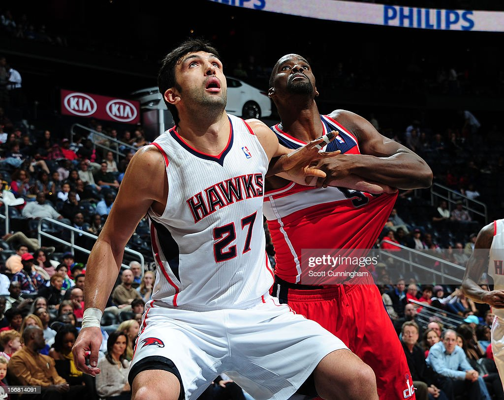 Zaza Pachulia #27 of the Atlanta Hawks looks up for a rebound vs the Washington Wizards at Philips Arena on November 21, 2012 in Atlanta, Georgia.