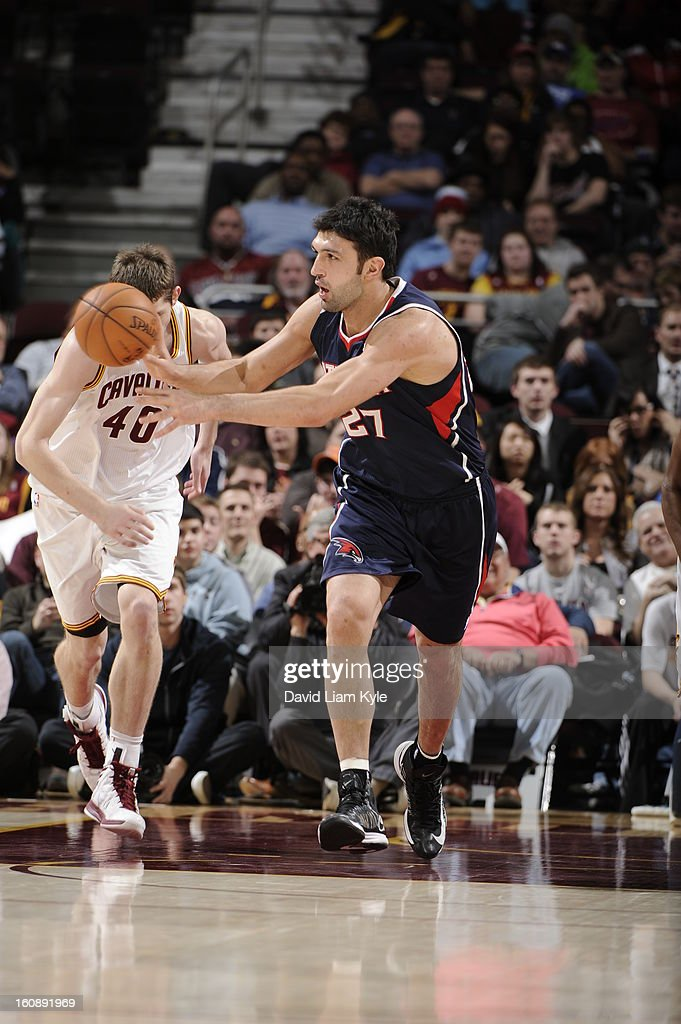 <a gi-track='captionPersonalityLinkClicked' href=/galleries/search?phrase=Zaza+Pachulia&family=editorial&specificpeople=202939 ng-click='$event.stopPropagation()'>Zaza Pachulia</a> #27 of the Atlanta Hawks passes the ball against the Cleveland Cavaliers at The Quicken Loans Arena on January 9, 2013 in Cleveland, Ohio.