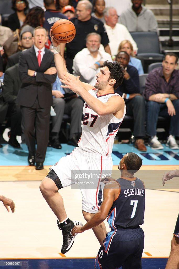Zaza Pachulia #27 of the Atlanta Hawks shoots against the Charlotte Bobcats at the Time Warner Cable Arena on November 23, 2012 in Charlotte, North Carolina.
