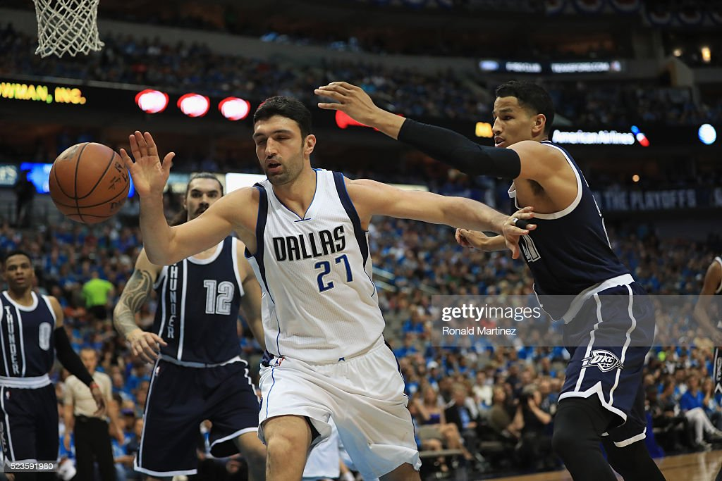 Zaza Pachulia of the Dallas Mavericks and Andre Roberson of the Oklahoma City Thunder reach for the ball during game four of the Western Conference...