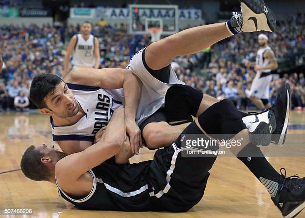 Zaza Pachulia of the Dallas Mavericks scrambles for the ball against Brook Lopez of the Brooklyn Nets in the second half at American Airlines Center...