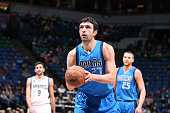 Zaza Pachulia of the Dallas Mavericks shoots a free throw against the Minnesota Timberwolves on January 10 2016 at Target Center in Minneapolis...