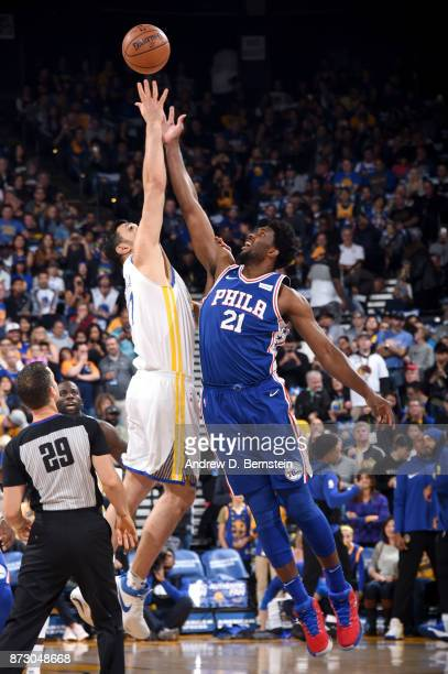 Zaza Pachulia of the Golden State Warriors and Joel Embiid of the Philadelphia 76ers tip off on November 11 2017 at ORACLE Arena in Oakland...