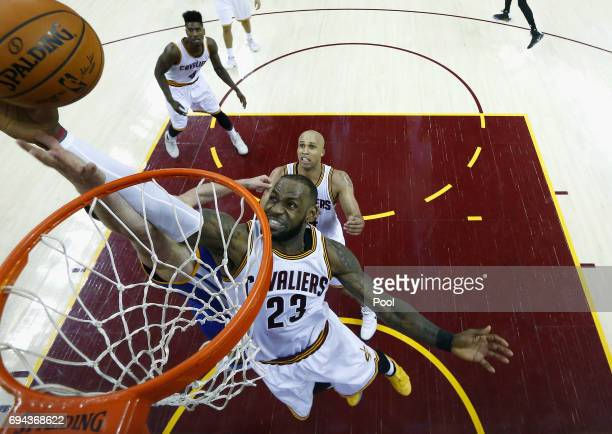 Zaza Pachulia of the Golden State Warriors and LeBron James of the Cleveland Cavaliers compete for the ball in the second half in Game 4 of the 2017...