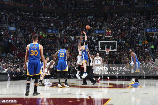 Zaza Pachulia of the Golden State Warriors and Tristan Thompson of the Cleveland Cavaliers go up for the opening tip off in Game Four of the 2017 NBA...