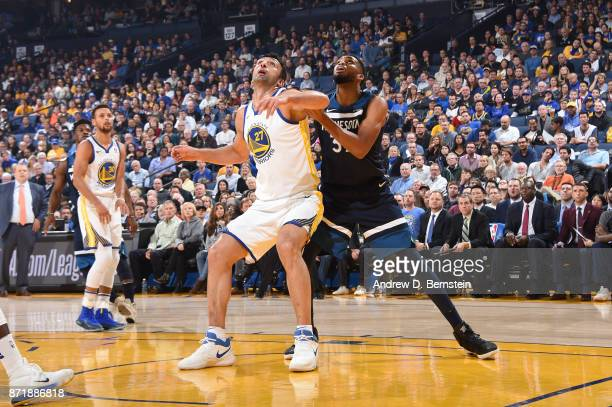 Zaza Pachulia of the Golden State Warriors battles for position against KarlAnthony Towns of the Minnesota Timberwolves on November 8 2017 at ORACLE...