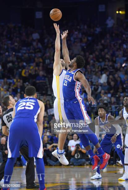 Zaza Pachulia of the Golden State Warriors battles for the tipoff with Joel Embiid of the Philadelphia 76ers during an NBA basketball game at ORACLE...