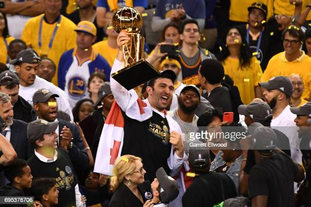Zaza Pachulia of the Golden State Warriors celebrates with the trophy after winning the NBA Championship after defeating the Cleveland Cavaliers in...