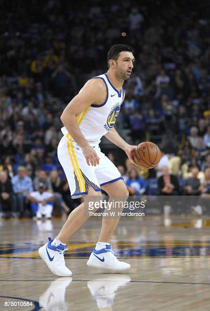 Zaza Pachulia of the Golden State Warriors dribbles the ball against the Philadelphia 76ers during an NBA basketball game at ORACLE Arena on November...