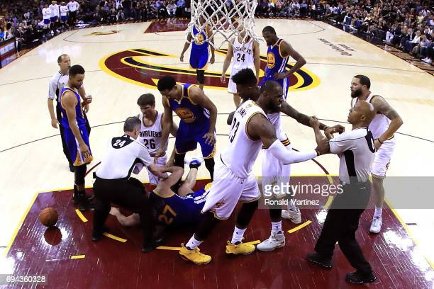 Zaza Pachulia of the Golden State Warriors gets tangled with Kyle Korver and Deron Williams of the Cleveland Cavaliers as LeBron James and Iman...