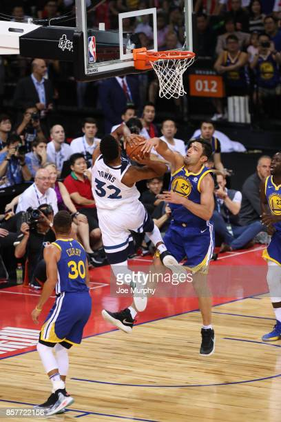 Zaza Pachulia of the Golden State Warriors goes for a block against KarlAnthony Towns of the Minnesota Timberwolves as part of the 2017 Global Games...