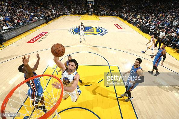 Zaza Pachulia of the Golden State Warriors goes to the basket against the Oklahoma City Thunder on January 18 2017 at ORACLE Arena in Oakland...