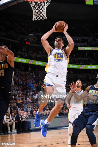 Zaza Pachulia of the Golden State Warriors goes to the basket against the Denver Nuggets on November 4 2017 at the Pepsi Center in Denver Colorado...