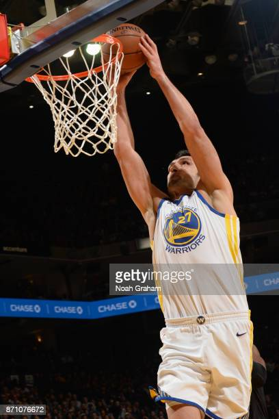 Zaza Pachulia of the Golden State Warriors goes to the basket against the Miami Heat on November 6 2017 at ORACLE Arena in Oakland California NOTE TO...