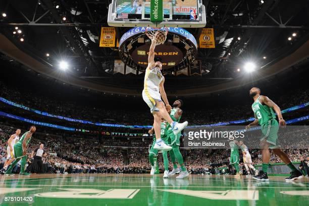 Zaza Pachulia of the Golden State Warriors goes to the basket against the Boston Celtics on November 16 2017 at the TD Garden in Boston Massachusetts...
