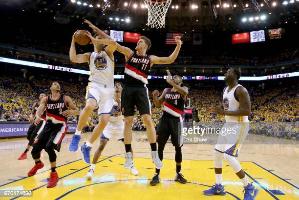 Zaza Pachulia of the Golden State Warriors goes up for a shot against Meyers Leonard of the Portland Trail Blazers Game Two of the Western Conference...