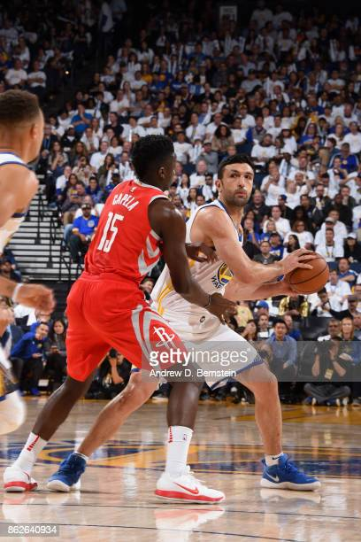 Zaza Pachulia of the Golden State Warriors handles the ball against the Houston Rockets on October 17 2017 at ORACLE Arena in Oakland California NOTE...