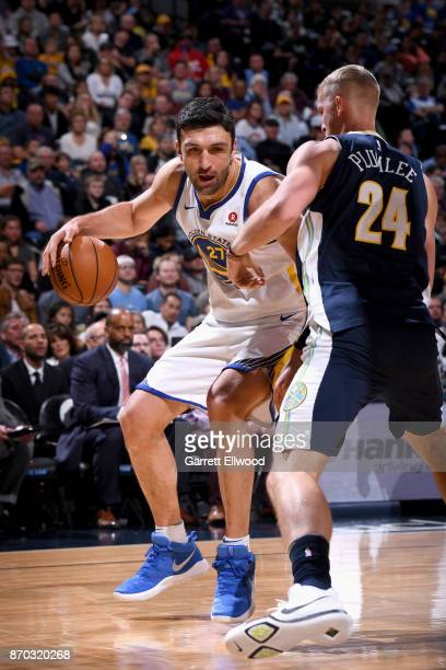 Zaza Pachulia of the Golden State Warriors handles the ball against the Denver Nuggets on November 4 2017 at the Pepsi Center in Denver Colorado NOTE...