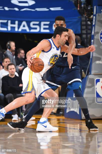 Zaza Pachulia of the Golden State Warriors handles the ball against the Minnesota Timberwolves on November 8 2017 at ORACLE Arena in Oakland...