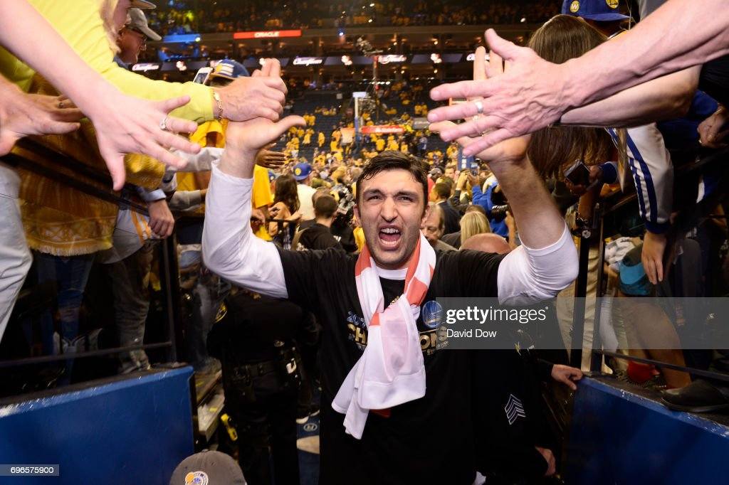 Zaza Pachulia #27 of the Golden State Warriors high fives fans as he walks off the court after winning Game Five of the 2017 NBA Finals against the Cleveland Cavaliers on June 12, 2017 at ORACLE Arena in Oakland, California.