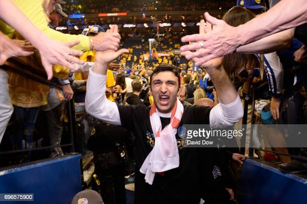 Zaza Pachulia of the Golden State Warriors high fives fans as he walks off the court after winning Game Five of the 2017 NBA Finals against the...