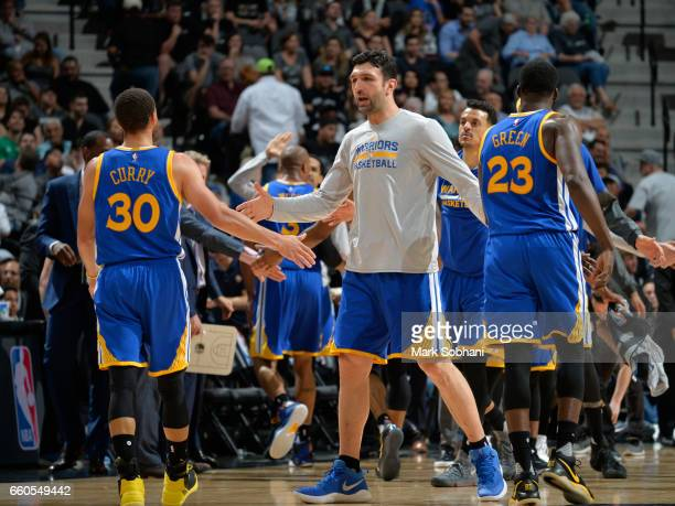 Zaza Pachulia of the Golden State Warriors high fives Stephen Curry during the game against the San Antonio Spurs on March 29 2017 at the ATT Center...