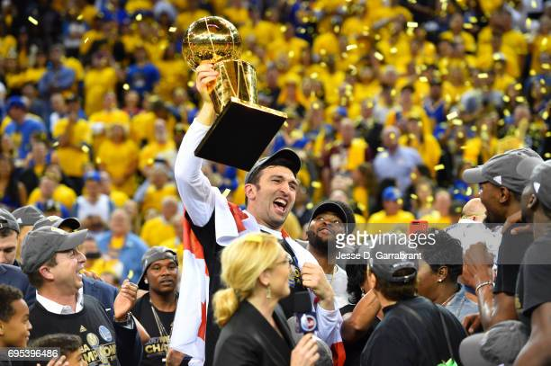 Zaza Pachulia of the Golden State Warriors holds up the Larry O'Brien trophy after winning the NBA Championship by defeating the Cleveland Cavaliers...
