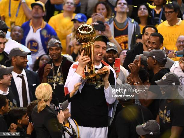 Zaza Pachulia of the Golden State Warriors holds up the Larry O'Brien NBA Championship trophy and celebrates after winning the NBA Championship...